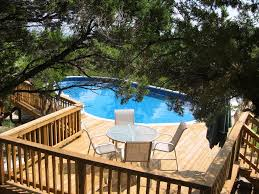 Architecture:Backyard Design With Small Round Pool Feat Brown Wood Above  Ground Wood Pool Deck