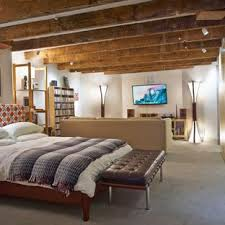 basement bedroom ideas before and after. Example Of A Mid-sized Trendy Gray Floor Basement Design With White Walls Bedroom Ideas Before And After