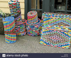 Colorful rubber doormats for sale outside shop Stock Photo ...