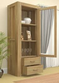 atlas chunky oak hidden home. our contemporary atlas glazed single door display cabinet with drawers chunky oak hidden home n