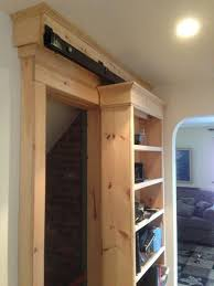 this shelf is actually a sliding door this is not your typical barn door and we love this practical solution