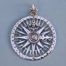 sterling silver compass rose pendant with fleur de lis design on any of the thumbnail images to view a larger image