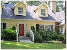 yellow house black shutters red door