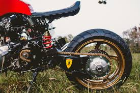the starting point was a 2006 honda cb600f hornet motor and frame then art sourced a vfr800 from a salvage yard and pillaged it for its swing arm