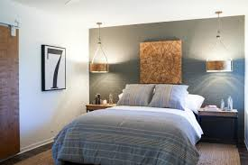 modern master bedroom with pendant lights