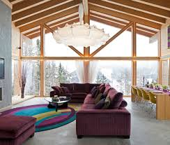 Floor to ceiling windows and vaulted ceiling