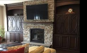 arched stone fireplace surround