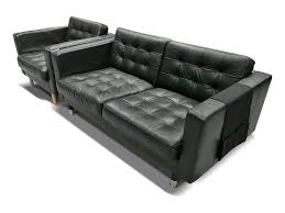 landskrona armchair and 2 seater sofa in black tufted leather