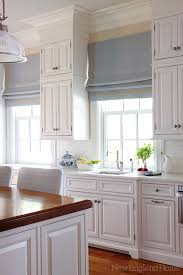 wood look island countertop in combo with a white countertop cabinets to ceiling crown mold is too large for my tastes the tall cabinet and then bare