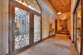 french front doorsMediterranean Entryway with French doors  Custom double front