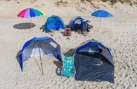 beach umbrella. Group Of The Best Beach Gear On Sand Umbrella