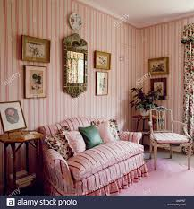 striped sofas living room furniture. Pink Striped Sofa In Country Living Room With Wallpaper Sofas Furniture C