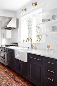 black appliance matte seamless kitchen: matte black cabinets with marble counter and backsplash classic but modern with gold hardware i would use a quartz marble look a like