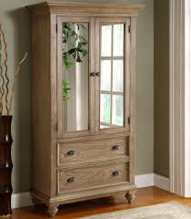 mirror armoire. 2 door mirror armoire with 5 drawers