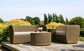 modern design outdoor furniture decorate. contemporary outdoor furniture design with wicker sofa and round coffee table decorated wooden deck flooring modern decorate