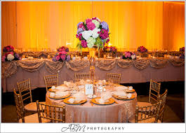 san diego sheraton head table backdrop with amber uplights beautiful color table uplighting