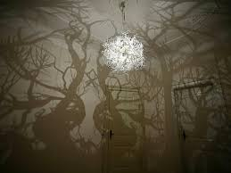 forms in nature hanging lights above and below an offering from hilden and diaz creates a forest of shadows on your wall