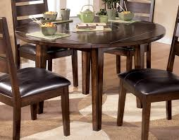 the larchmont round dropleaf dining table signature design with dining table drop leaf prepare