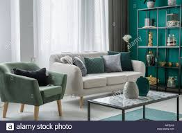 Light grey couch Living Room Green And Silver Decorative Pillows Placed On Light Grey Couch Standing In Living Room Interior With Windows Armchair And Marble Table Aeroscapeartinfo Green And Silver Decorative Pillows Placed On Light Grey Couch