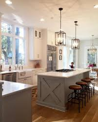 ... View in gallery Traditional white kitchen with a large island and  antique industrial-style lighting