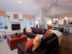 living room ideas with brown sectionals. See The Luxurious Brown Leather Sectional And Grand White Fireplace In This Open-concept Living Room Ideas With Sectionals I
