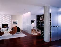 home office in living room. frosted glass room divider separates the modern living from beautiful home office design in