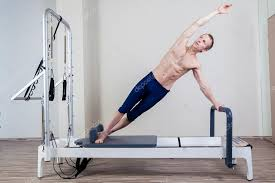 pilates reformer workout exercises man at gym indoor stock photo