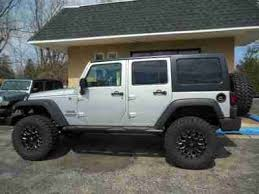 unlimited jk 4 door lifted 4 inch lift 35 tires 7 k miles 1 owner clean