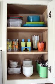 innovative organising kitchen cabinets iheart organizing its here the kitchen cabinet tour