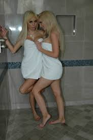 Two horny blonde lesbians are having sex in the bathroom Porn Pics
