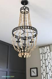 painted wood bead chandelier diy wood bead chandelier tutorial life on virginia street on remodelaholic