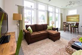 yellow sofa with tan walls wall colord brown sofas for agreeable green living room curtains rugs