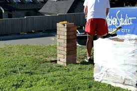 brick pillars for fence cant wait until we can actually attach those pillars to the fence so they just look like random free standing bricks diy brick