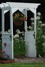 the best diy projects diy ideas and tutorials sewing paper craft diy diy crafts ideas arbor made from two old doors one of the best uses for old doors