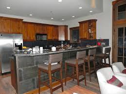 backsplash metal light brown wooden kitchen cabinet glossy dark gray kitchen cabinet simple wooden flooring black and white backsplash mozaic tiles beige
