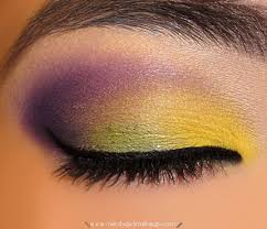 this eyeshadow look does not feature a mardi gras green but she has created a very bold look and pulls it off well a matte yellow was used on the inner