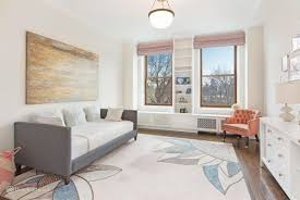 living room design photos gallery. This Living Room Is Perfect For Kids. With A Sofa Bed On Beautiful Rug Along Nice Wall Design And Perfectly Placed Glass Walls, Should Be Photos Gallery S