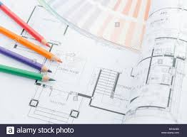 modern architectural drawings. Architects Workplace - Architectural Drawings Of The Modern House With Color Pencils And Sample Colors. Decoration Concept. Designer Tools.