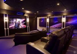 modern home theater. modern home theater with fiber optic star ceiling tiles, box ceiling, wall sconce, a