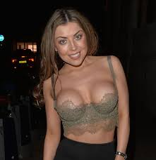 Abigail Clarke puts her surgically-enhanced chest on show in a daring  outfit on night out - Mirror Online