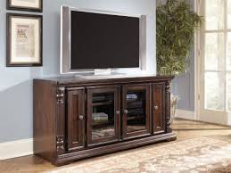Signature Design by Ashley Kingston TV Stand   Metal tv stand, Tv stand,  Solid wood tv stand