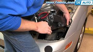 how to install replace headlights and bulbs ford focus  how to install replace headlights and bulbs ford focus 03 04 1aauto com