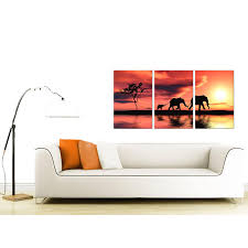 display gallery item 4 set of 3 wildlife canvas prints uk 125cm x 60cm 3102 display gallery item 5  on hand painted canvas wall art uk with elephants canvas prints set of 3 for your living room