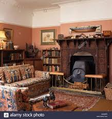 Terracotta Living Room Black Stove In Carved Wooden Fireplace In Nineties Living Room
