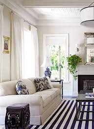 modern coastal living room with a versatile white sofa blue design of living spaces rugs