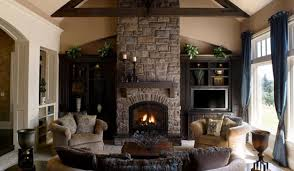decorations stone fireplace at winter living room with cream fabric sofa and wooden coffee table