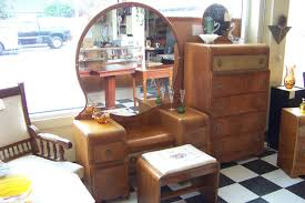 cute antique vanities with mirror in round shape on checd tile