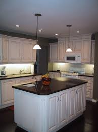 lighting for kitchen islands. Kitchen:Simple Lighting Kitchen Decor With Rectangle White Island And Brown Wood Floor Added For Islands