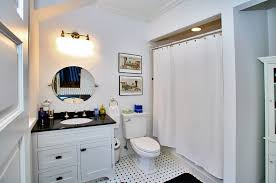 white bathroom cabinets with dark countertops. dark countertop white bathroom cabinets under round mirror and led wallsconces also toilet over mosaic with countertops r