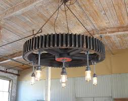 bespoke authentic vintage wooden factory gear pattern with antique explosion proof lighting a selection of